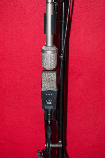 AKG C-414 and Nuemann KM86 using mid-side.  Allows for different microphones and great mono compatibility.