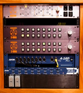 Closeup on the rack with gear from Dangerous and Aviom.